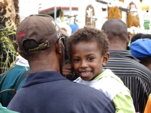 A young boy and his father take in a performance at the festival