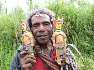 A man in Hula Province, in the Highlands, selling his handmade wooden figures.