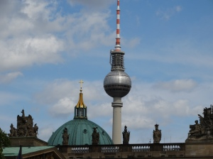 Two skyline icons of the new and old Berlin: the rebuilt Neue Synagoge and the Fernsehturm on Alexanderplatz.