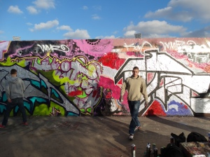 Young spray paint artists continue to make new art on an old section of the Wall.